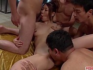 There are a lot of men surrounding Japanese girl and hairy pussy is ready to welcome each cock