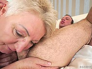 Short-haired old lady wants to gladden young fucker and licks guy's hairy anus during sex 10
