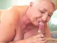 Short-haired old lady wants to gladden young fucker and licks guy's hairy anus during sex 11