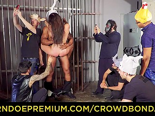 Imperious black man roughly nails submissive brunette while they are surrounded by strange guys