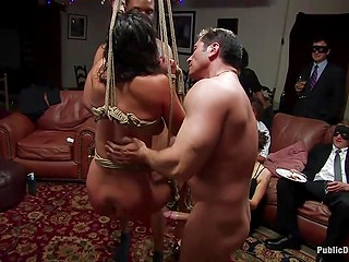 Party guests watch with interest men fucking tied up Latina girl Charley Chase in turn