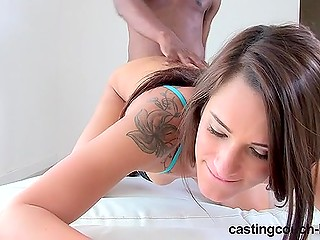 Good-looking girl with tattoo on shoulder discovers the benefits of interracial sex at porn casting