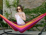 Fetching Latina Jenna Sativa needs to satisfy pussy and she fingers it on the hammock 4