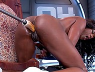 Fuck-machine penetrates into the wet pussy of black chick at high speed while she is stimulating clitoris with vibrator 11