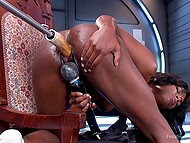 Fuck-machine penetrates into the wet pussy of black chick at high speed while she is stimulating clitoris with vibrator 6