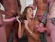 Skinny bitch gets is in hands of several powerful males who demonstrate what a gangbang is 11