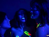 Lesbians throw a fluorescent party in the bedroom and practice anal masturbation with vibrator usage 6