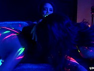 Lesbians throw a fluorescent party in the bedroom and practice anal masturbation with vibrator usage 7