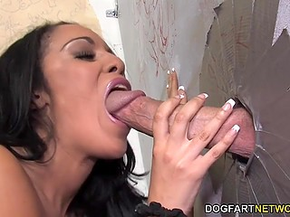 Ebony hottie came in wrong side of town to have fun with white cock stuck out of gloryhole