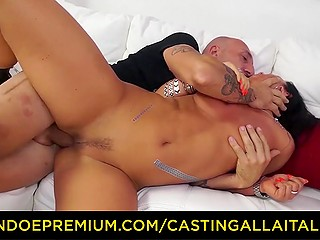 Italian girl with black hair has grown old but still adores being fucked in ass by stallion on camera