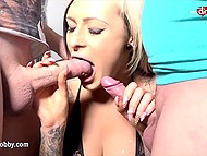 Gorgeous German blonde Mila Elaine will suck two cocks until men ejaculate on her face