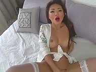 Young Japanese in the silk gown and stockings uses ribbed dildo for self-satisfaction 4