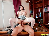 Likable Asian student really needs a good mark and she rides principal's cock on the table
