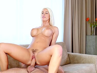 After sixty-nine position, platinum blonde lovely makes partner understand that she likes cock riding most of all
