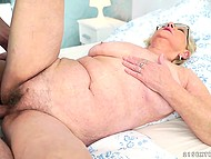 Young lover takes pictures of old woman touching tits and fucks her on the bed after licks pussy 10
