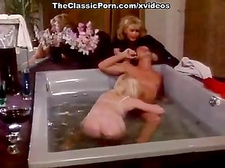 Vintage porn video where blonde in stockings rides cock and gives mustached man blowjob in jacuzzi