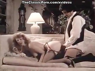 Two succulent beauties from a vintage porn clip shared partners and went with them for sex