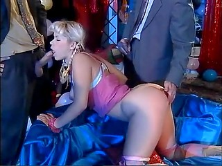 Blonde whore with pigtails made the choice to suck dicks and be double penetrated in stage