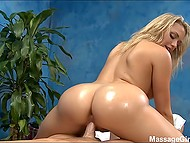 Oiled up masseuse Mia Malkova jumps on customer's prick for unforgettable ride