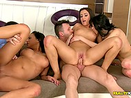 Men find out that three sultry nymphos live next door and bring them to apartment for group fuck