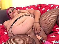 BBW with a pretty figure moans while sex-machine is shoving dildo deeper and deeper inside vagina 7