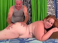 Gray-haired man gives pleasure to fat redhead using his tongue and powerful vibrator