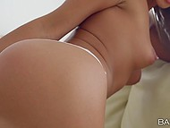 Tanned girl with beautiful face is excited so she puts magazine down and masturbates pussy 6