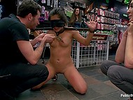 Crazy public disgrace of hot blindfolded girl in posture collar surrounded by horny people in store