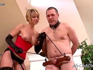 Busty woman in red corset and stockings shows husband her dominant nature and spanks bruised buttocks