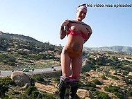 Eccentric chick flashes perky tits and shaved pussy on rocky ledge for cameraman 4