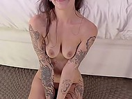 Tattooed girl with ear stretching plugs practices threesome at porn casting and guys cum on her face 11