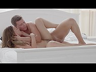 Lascivious guy gets it on with love on white sheets and after passionate banging profusely creampies her 9