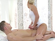 While man makes incredible faces, blonde masseuse is quietly receiving his cock in pussy 7