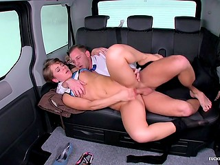 Porn shooting in a cab is in full swing and male actor demonstrates model how she must have sex