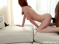 Pale-skinned girl with red hair has sex with black partner and tries to make him cum by blowjob