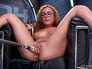 Nerdy cutie with curly hair will definitely reach orgasm thanks to powerful vibrator and fucking machine