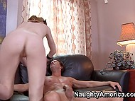 Pale girl rides fucker's strong cock and they practice spoons sex position on the couch 5
