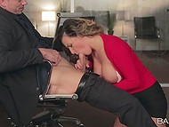 Office woman wears suit that emphasizes her charms and entices subordinate into blowjob
