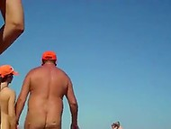 A lot of women walk on the beach being naked on a sunny day and voyeur films them 6