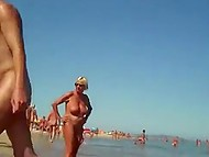 A lot of women walk on the beach being naked on a sunny day and voyeur films them 9