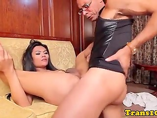 Asian shemale by the name of Rose answers the questions and sucks black dick before assfucking