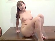 Pretty girl from Japan has the opportunity to play with herself and she masturbates smooth pussy