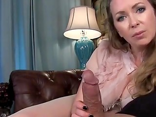 Slinky stepmother in pantyhose and with big titties covered with bra gives handjob to guy