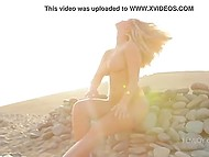 Stony beach becomes more beautiful when erotic naked model comes there for photo session 4