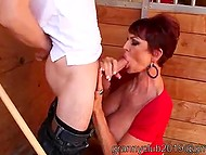 Lustful mature redhead with big tits brings employee to stable and sucks guy's cock