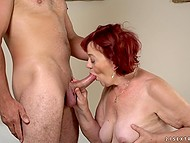 Red-haired granny blows cock of young lover until he rewards her with mouthful of jizz