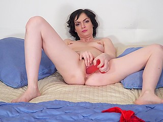 Brunette MILF has a red dildo and now woman is going to show how skilfully she masturbates pussy