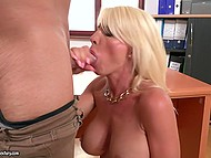 Platinum blonde MILF with beautiful face sucks boss' penis and smears big tits with semen 4