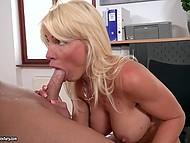 Platinum blonde MILF with beautiful face sucks boss' penis and smears big tits with semen 8