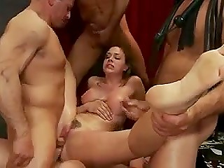 Excited stallions brutally penetrate submissive whore before exploding with jizz on her face